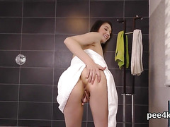 Fantastic chick is urinating and fingering trimmed cunt