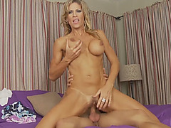 A fabulous blonde MILF with perfect breasts rides horny man's big stiff penis