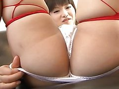 Akane Ozora  loves cosplay and she dresses up in a French maid outfit with red fishnet thigh highs before using a mini vib on her pussy