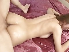 Two guys oil up sexy Sayaka Fukuyama and feed her their cocks