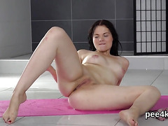 Luscious girl is peeing and pleasing shaven snatch