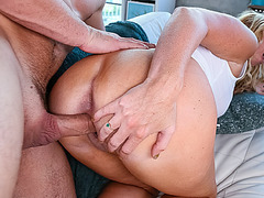 Stepmom squeezes balls while licking cock