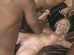 Blonde slut anal banged by big black cocks on the couch
