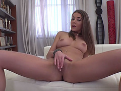 Busty brunette fingers her wet pussy while getting filmed