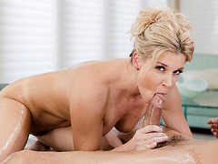 Oily MILF masseuse blows clients fat cock
