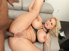 The blonde MILF Ryan Conner drops to her knees