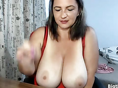 Brunette has natural giant tits