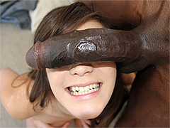 Holly Michaels deepthroats black cock