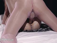 Young lesbians enjoying erotica with dildo