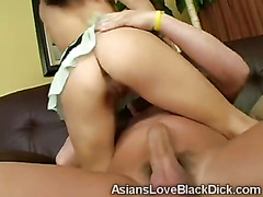 Oriental beauty uses her wet holes to please a huge dick