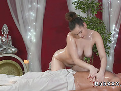 Busty babe giving massage to masseur
