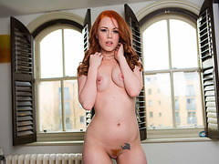 Redhead Ella Hughes takes a big cock into her pussy