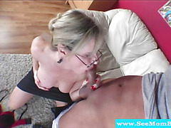 Horny MILF with glasses drools on cock