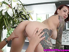Busty tattooed lesbian receives oral