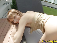 Blonde fetish babe flashes her tight ass