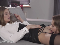 Two extreme girls having sex on red couch