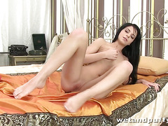 Raven haired Jessica fills her tight ass with a butt plug