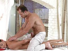 Stunning babe rides masseurs cock