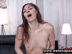 Horny brunette fingers her pissy pussy