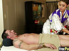 Asian beauty Jayden Lee gives a naughty massage to a dick